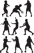 Multiple silhouettes of people playing with frisbee