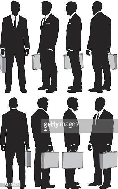 multiple silhouttes of businessmen - full suit stock illustrations
