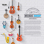 Music instruments on white modern brick wall concept