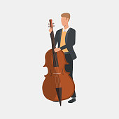 Musician standing and playing cello