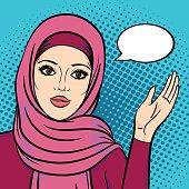 Muslim arabic woman in hijab pointing on speech bubble