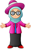 Muslim girl wearing blue veil and pink clothes presenting