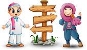 Muslim kid couple and blank wood arrow sign
