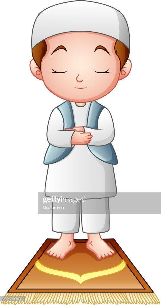Muslim kid praying isolated on white background