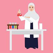 Muslim woman chemistry student wearing hijab