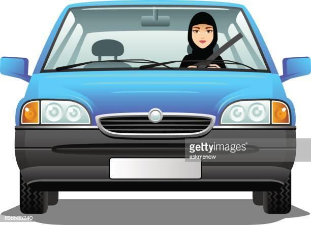 Muslim woman driving a car