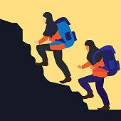 Muslim woman wearing a hijab hiker climbing rock on mountain