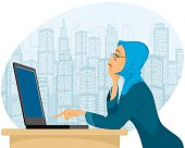 Muslim woman with laptop
