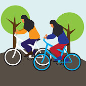 Muslim women cyclists wearing a hijab cartoon character. vector illustration