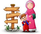 A muslim women hold her son head and blank wood arrow sign