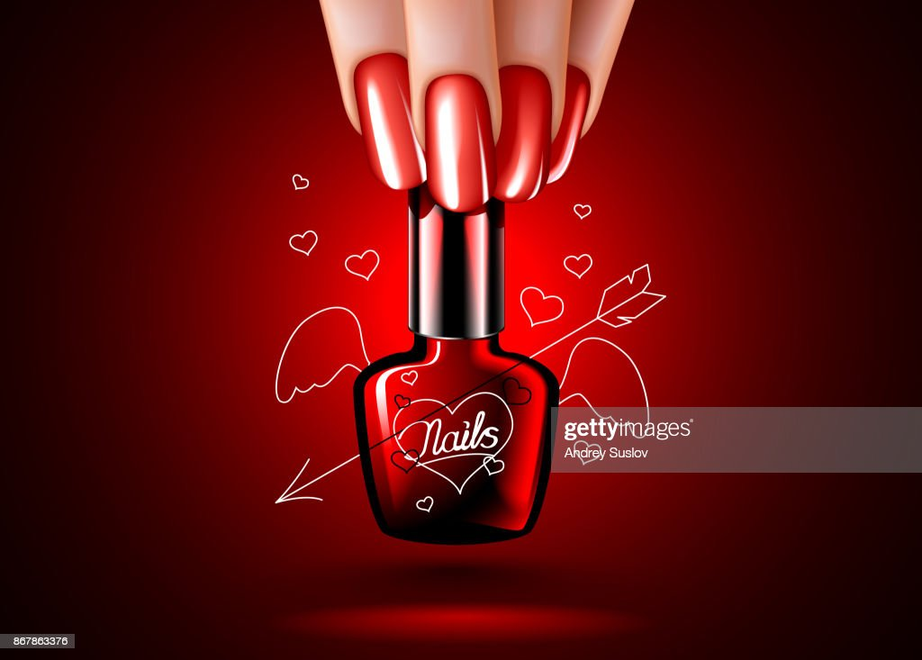 nail polishes with hearts in a woman hand. a beautiful manicure.