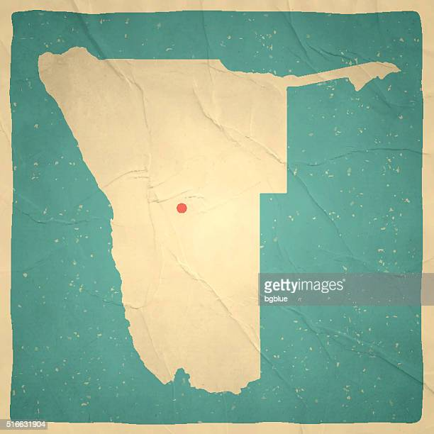 namibia map on old paper - vintage texture - namibia stock illustrations, clip art, cartoons, & icons