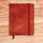 Natural Leather Notebook On A Wooden Desk. Copybook With Band