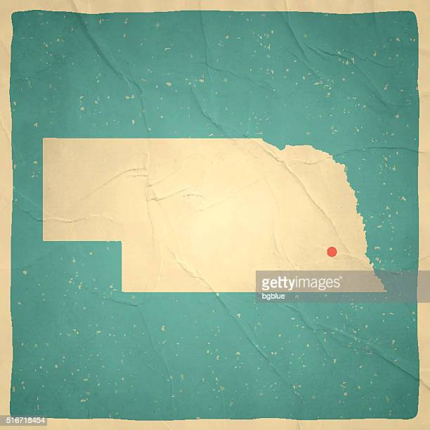 nebraska map on old paper - vintage texture - lincoln nebraska stock illustrations