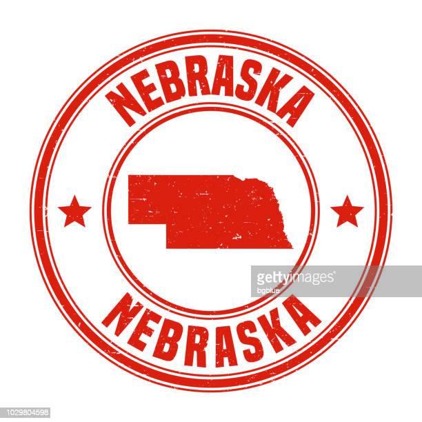nebraska - red grunge rubber stamp with name and map - nebraska stock illustrations