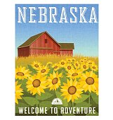 Nebraska travel poster. Vector illustration of sunflowers in front of old red barn.