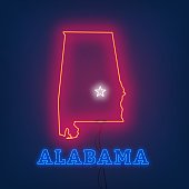 Neon map State of Alabama on dark background.