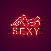 Neon sexy girl signboard.