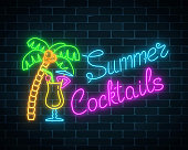 Neon summer cocktails bar sign. Glowing gas advertising with pina colada alcohol shake and palm.