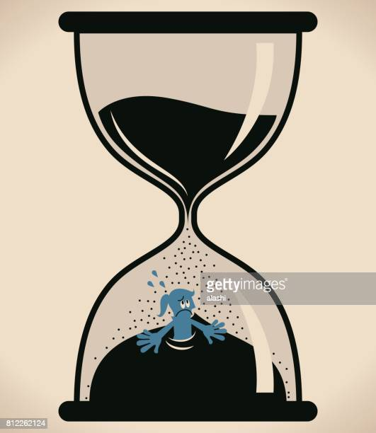 Nervous Businesswoman (woman, girl) inside hourglass ( flooded in sand clock), time running out