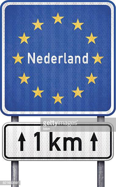 stockillustraties, clipart, cartoons en iconen met netherlands border traffic sign with white 1 km ahead sign - lolon