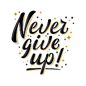 Never give up! brush lettering sign with golden stars.