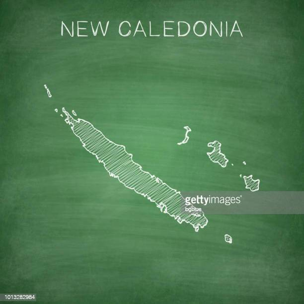 new caledonia map drawn on chalkboard - blackboard - french overseas territory stock illustrations
