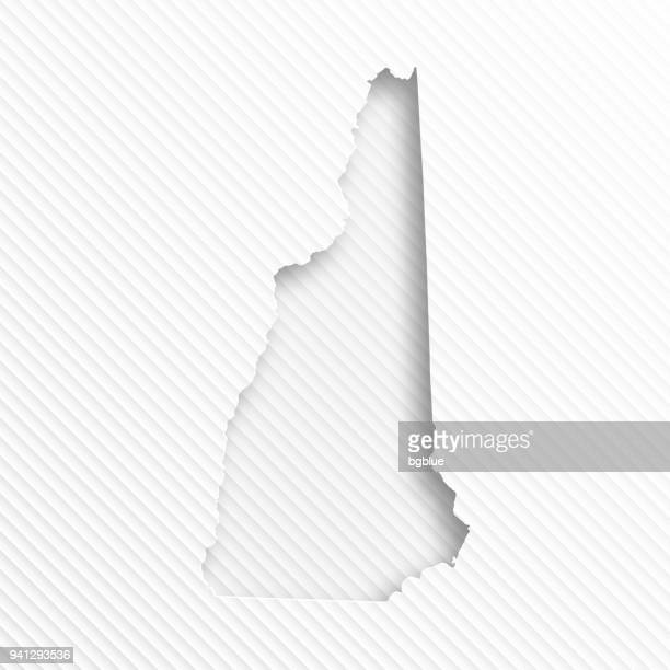 New Hampshire map with paper cut on abstract white background