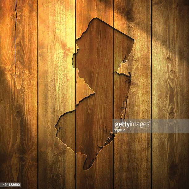 New Jersey Map on lit Wooden Background