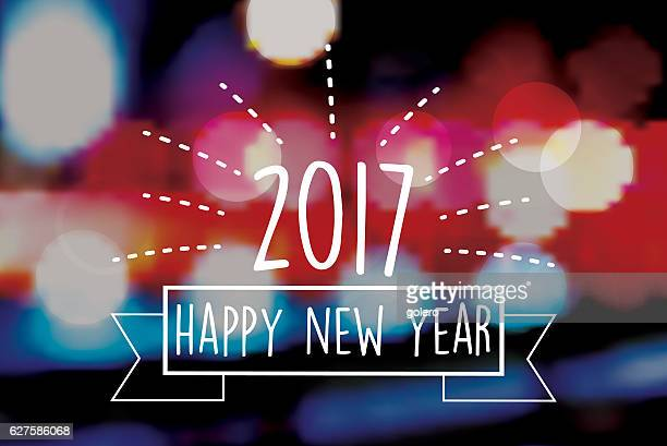 new year 2017 text symbol on blurred fireworks background