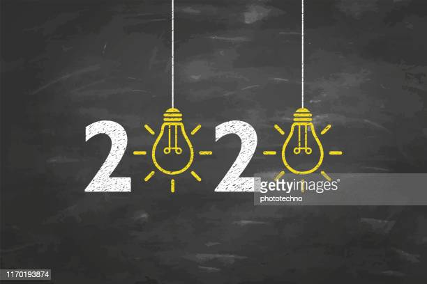 new year 2020 idea concepts on blackboard background - finance and economy stock illustrations