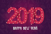 """New Year background with light bulbs and hand made lettering calligraphy phrase """"Happy New Year.2019"""". Pattern with hand drawn symbols. Banner,poster, flyer, brochure."""