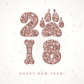 2018 New Year creative banner with shining rose gold numbers, dog paw print and bone. Vector template for design projects, 2018 Chinese New Year. All isolated and layered