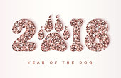 2018 New Year creative greeting card with shining rose gold numbers, dog paw print and bone. Vector template for business design projects, 2018 Chinese New Year wishes. All isolated and layered