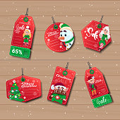 New Year Sale Tags Set With Elfs Over Wooden Texture