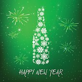 New year's eve champagne bottle on green background
