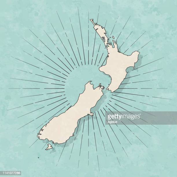 new zealand map in retro vintage style - old textured paper - new zealand stock illustrations