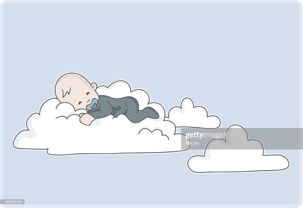 newborn baby boy sleeps on a cloud