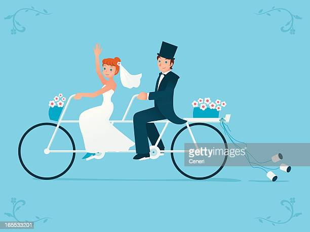Newlywed bride & groom riding on a Tandem bicycle