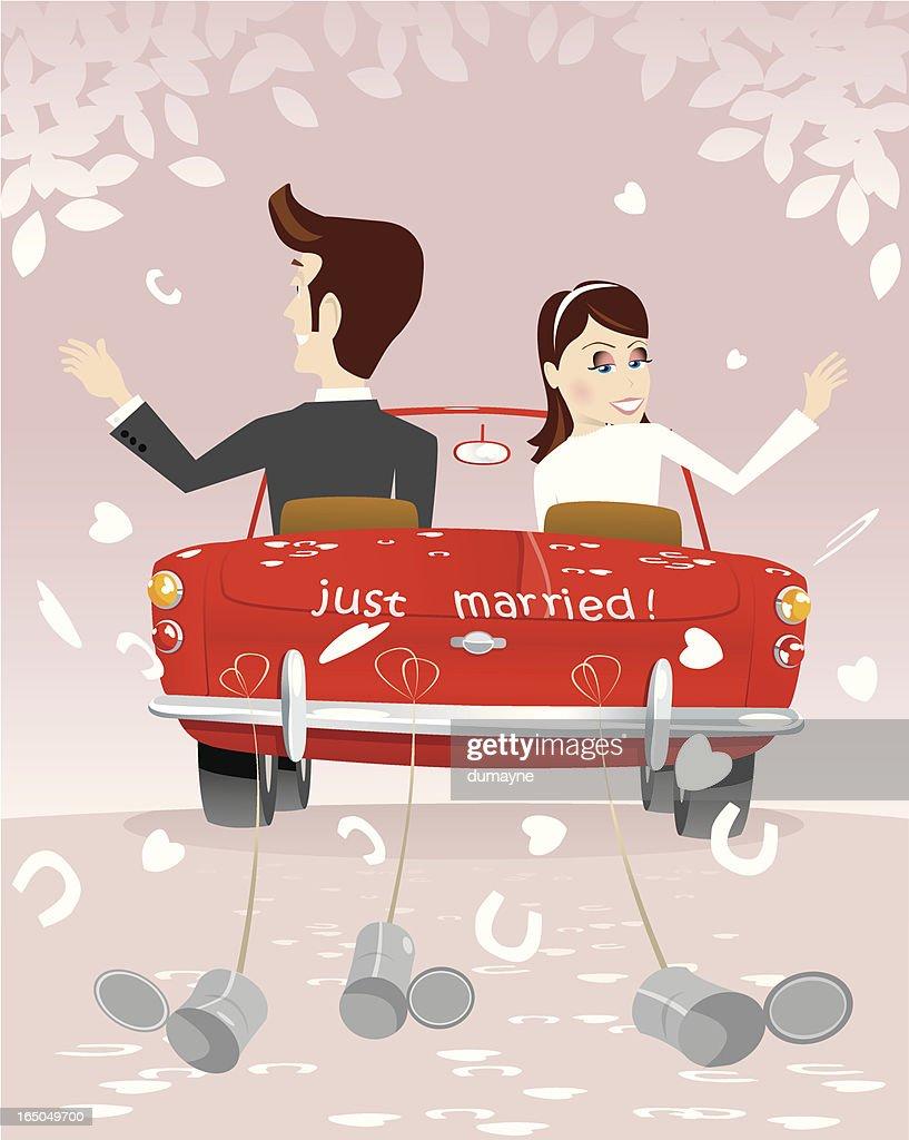 Newlywed couple driving away on honeymoon