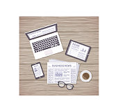 News concept. Daily information from different resources on the screens of devices and in the paper. News on laptop, tablet, phone, newspaper with coffee and glasses on a wooden desk.