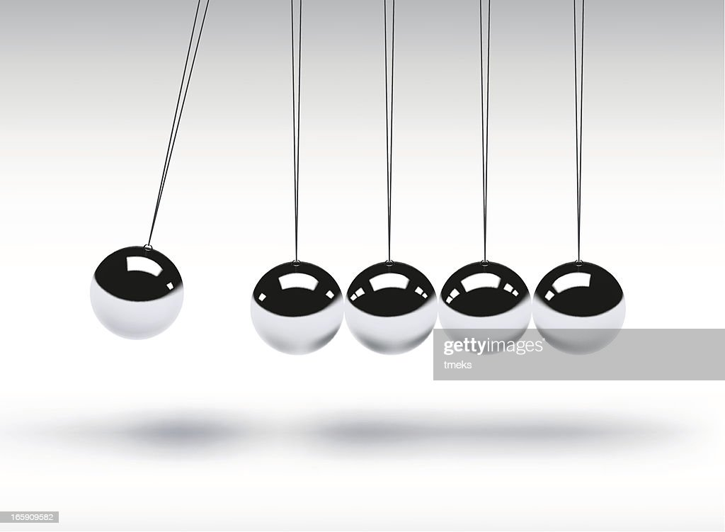 Newtons cradle showing balancing balls
