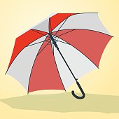 Nice red and white open umbrella parasol on yellow background.
