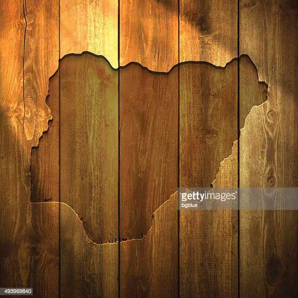 Nigeria Map on lit Wooden Background