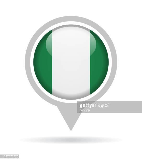 nigeria - vector round flag pin glossy icon - abuja stock illustrations