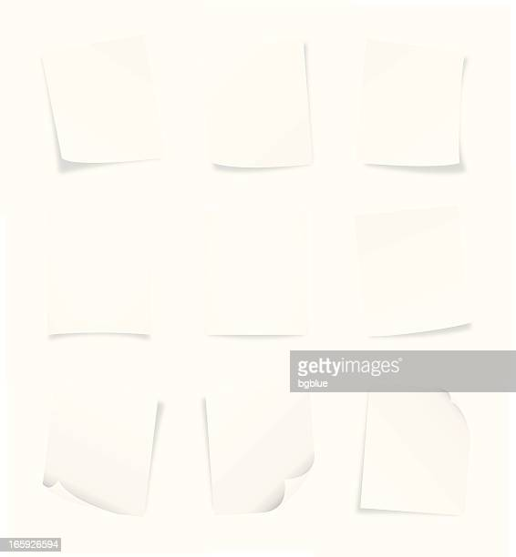 Nine blank pages of paper arranged on white background