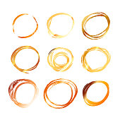 Nine golden hand drawn scribble circles isolated on white