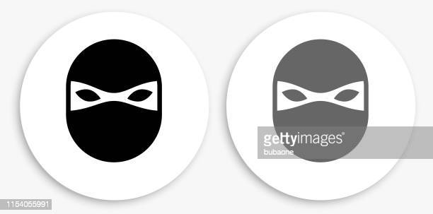 ninja mask black and white round icon - black mask disguise stock illustrations