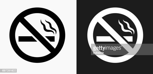 no cigarette smoking icon on black and white vector backgrounds - smoke stock illustrations, clip art, cartoons, & icons