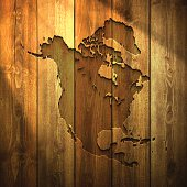North America Map on lit Wooden Background